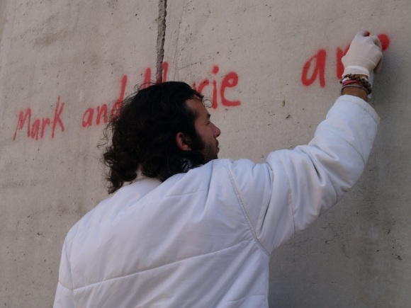 Dude in Palestine doing some graffiti for me.